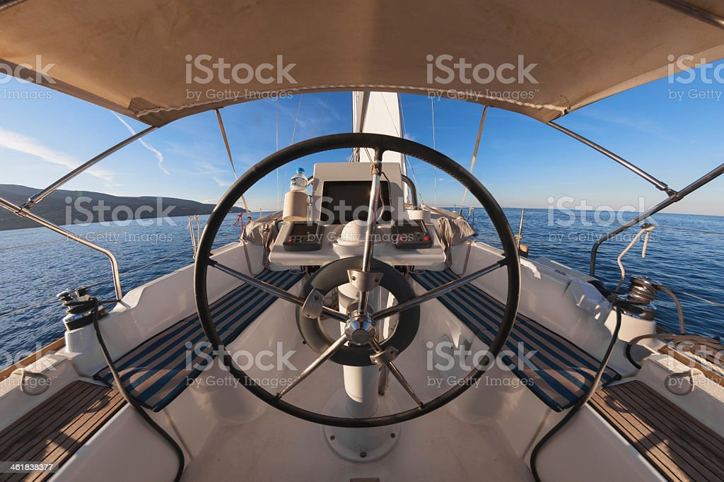 The drivers seat on a boat in the water stock photo