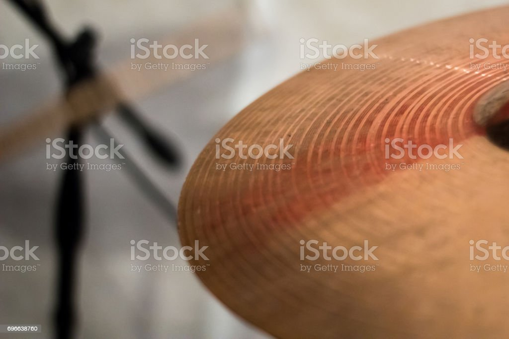 The drum stick hit on the crash cymbal in the low key background stock photo