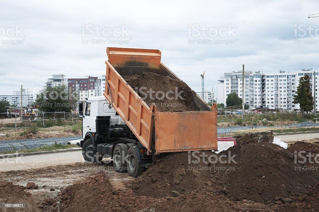 The Dumper Truck Unloading stock photo