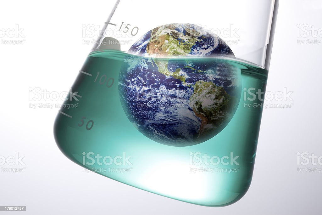 The Earth being researched in a test tube stock photo