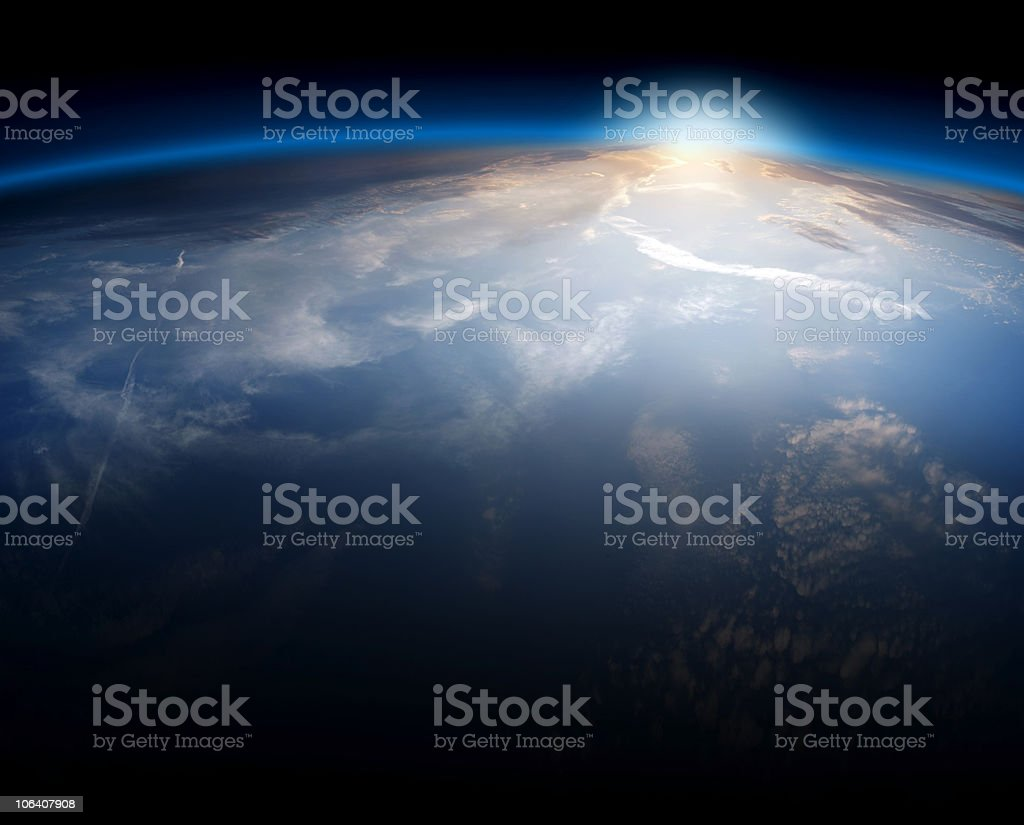 The Earth seen from space as the sun rises stock photo
