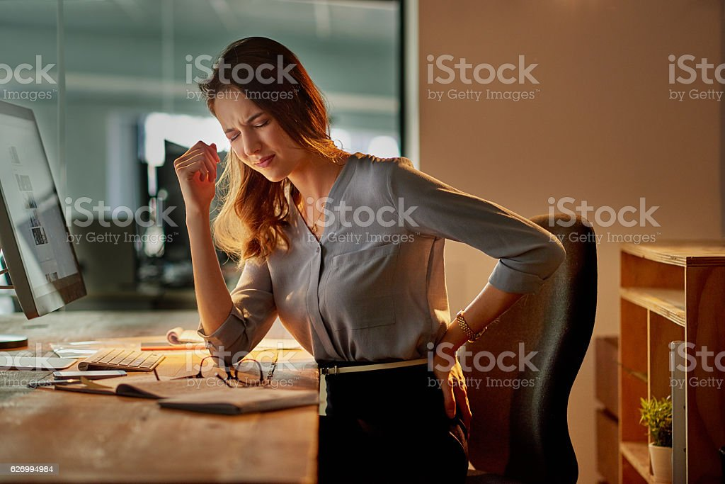 The effects of sitting for hours on end stock photo