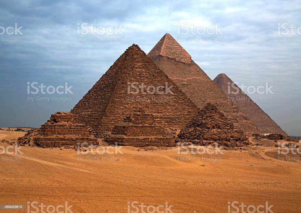 The Egyptian pyramids in the background of the desert. stock photo