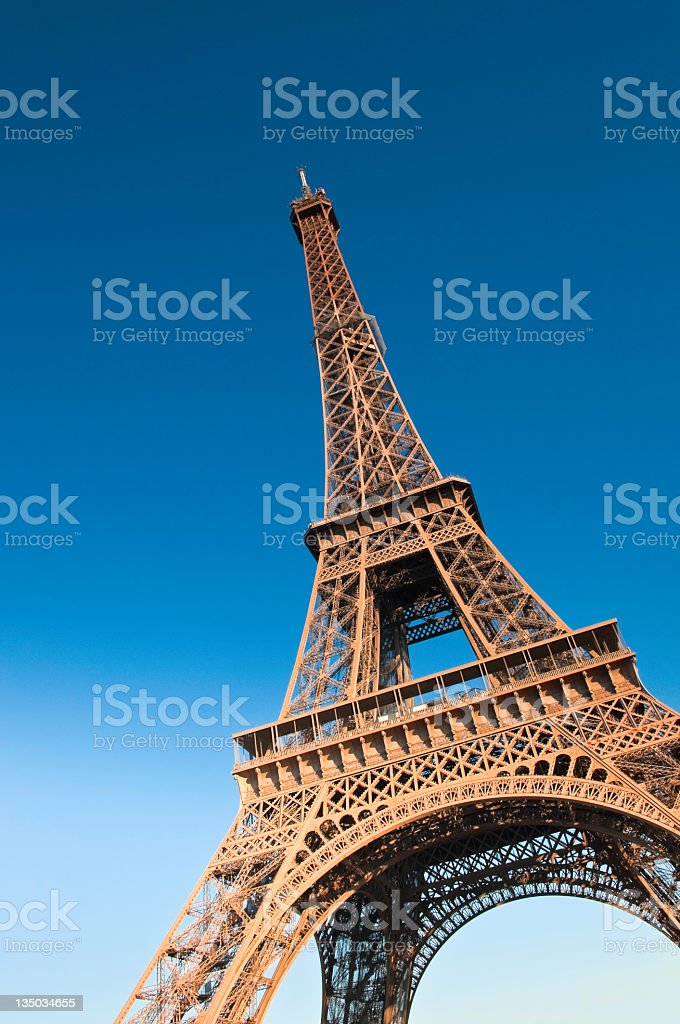 The Eiffel Tower in Paris standing in the blue sky royalty-free stock photo
