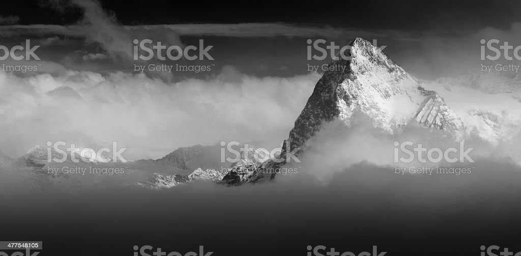 The Eiger North Face Switzerland Alps rising above the clouds stock photo