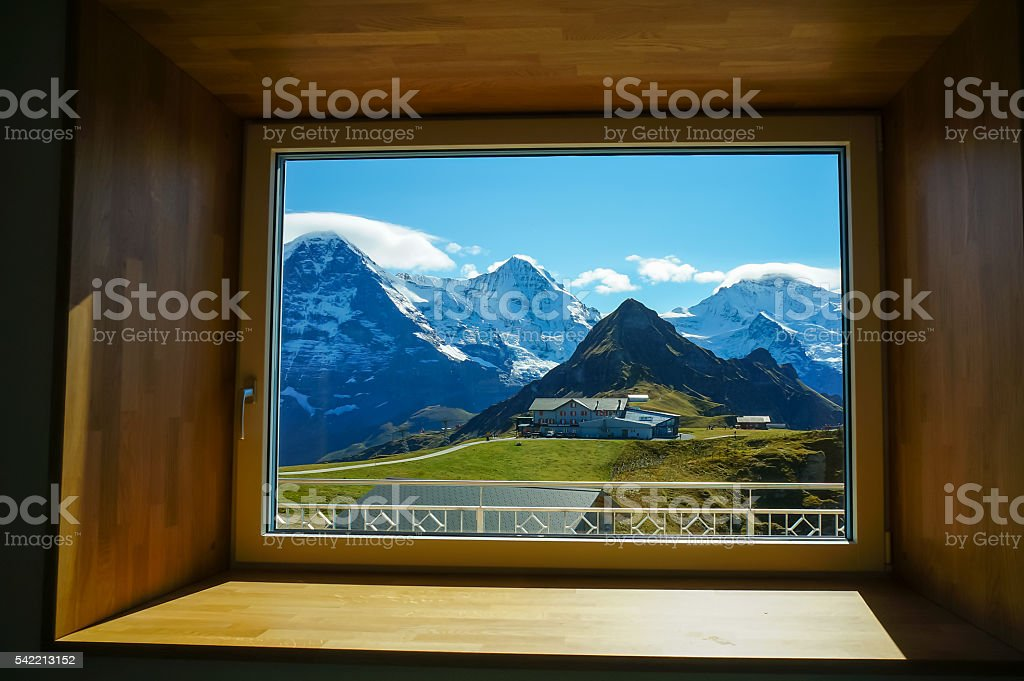 The Eiger,Monch,Jungfrau famous summit through the window stock photo