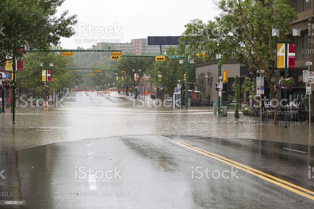 The Elbow River flows over 4th Street. stock photo