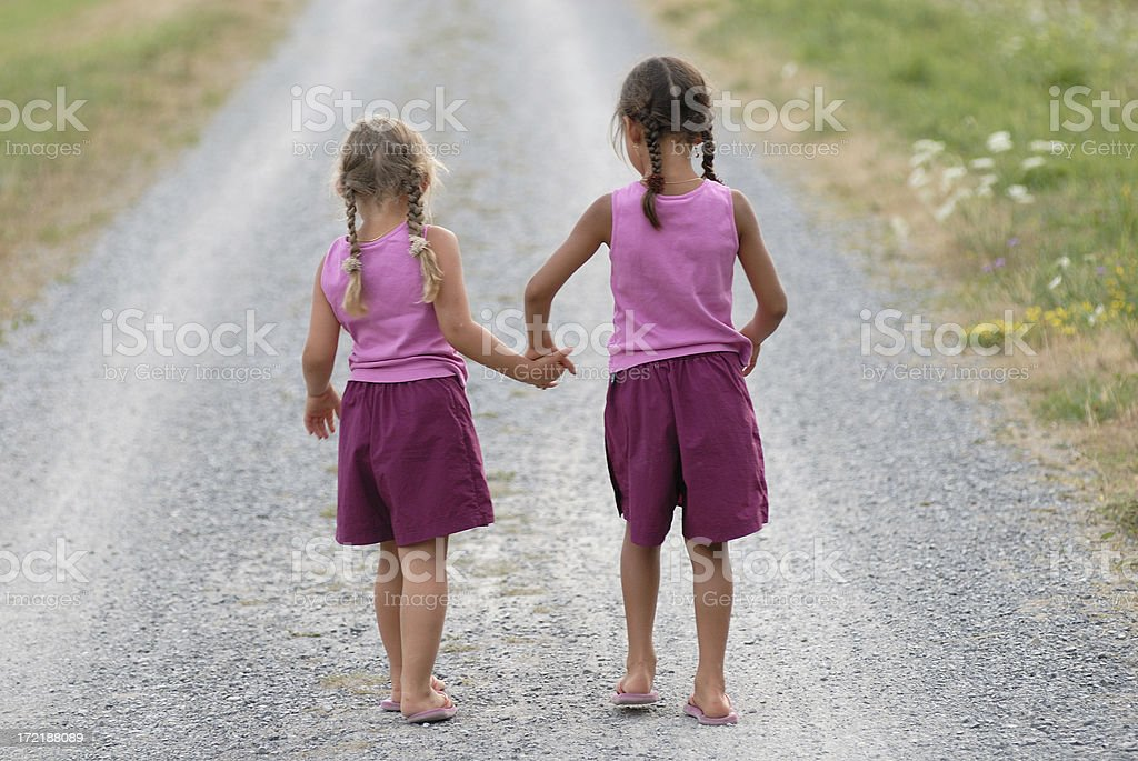 The elder sibling leading the younger sister! stock photo