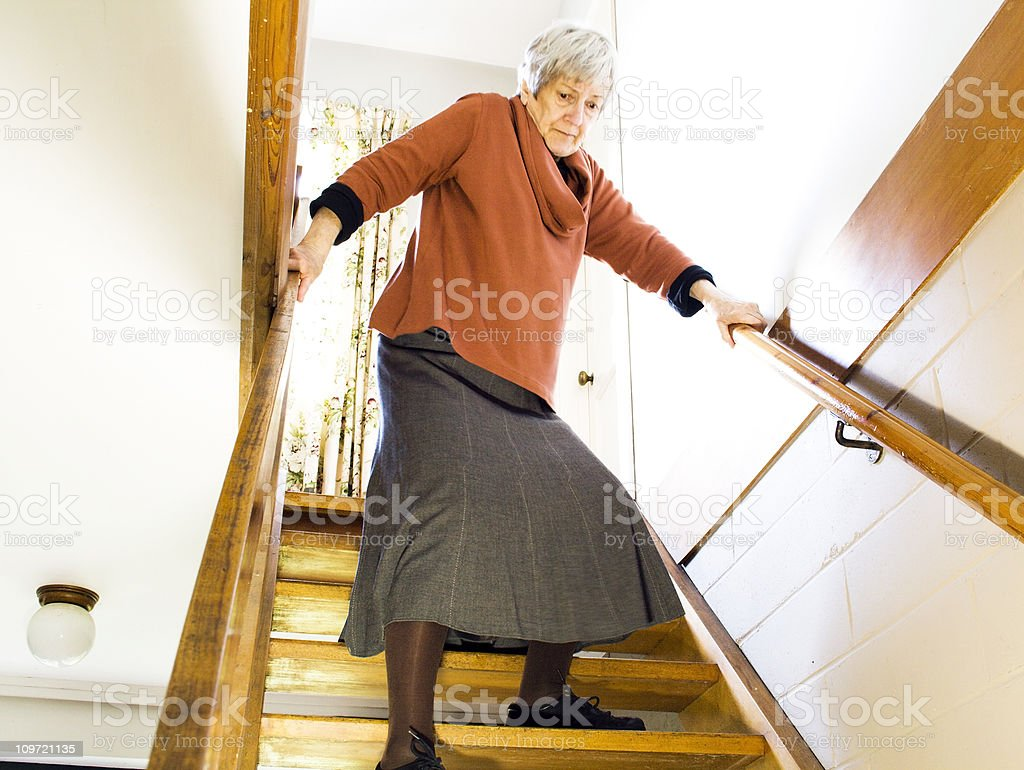 The Elderly and Stairs: Descending stock photo