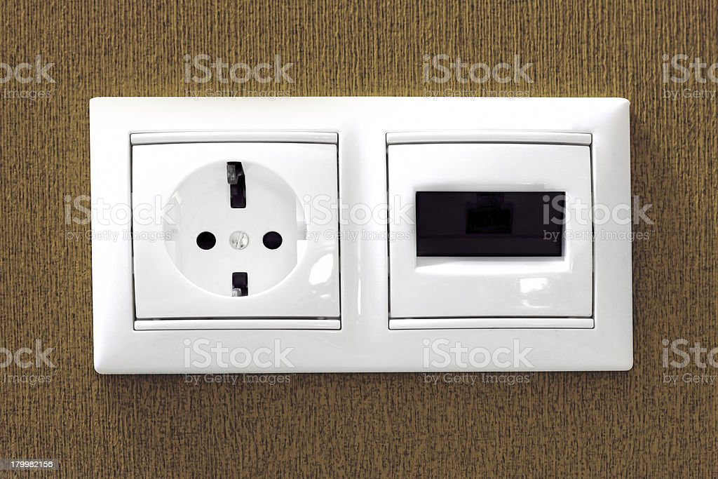 The electric and phone  sockets stock photo