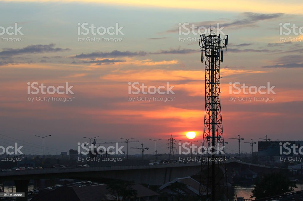 The electricity and communiction network wire on sunset backgrou stock photo