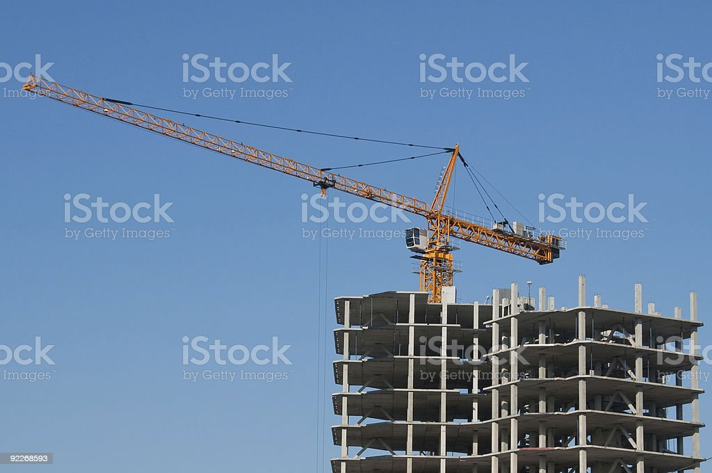 The elevating crane on clear blue sky background royalty-free stock photo