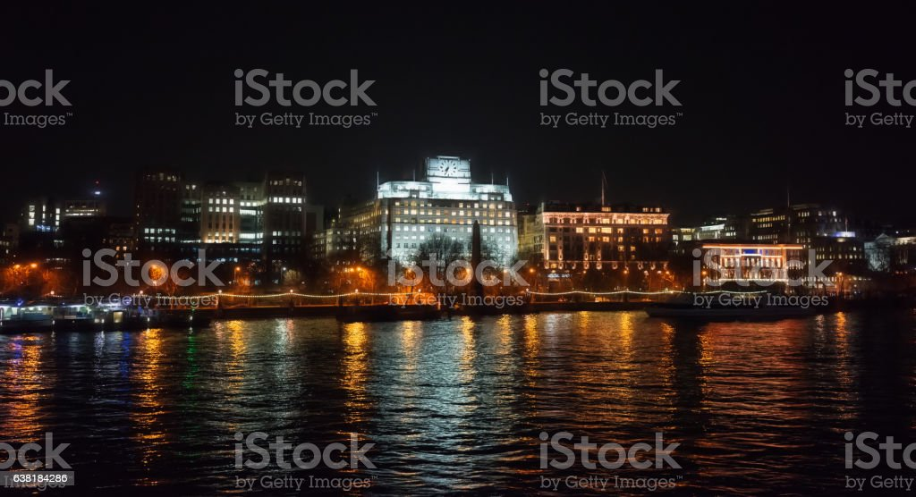 The Embankment side of the River Thames in London stock photo