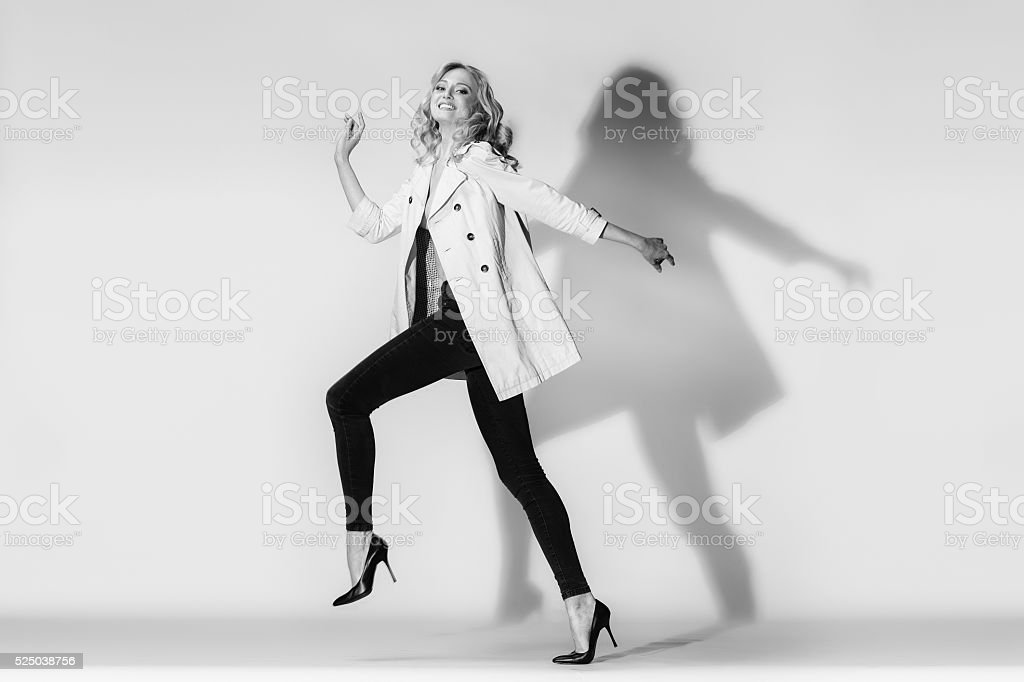 The emotional model running in leggings on a white background. stock photo
