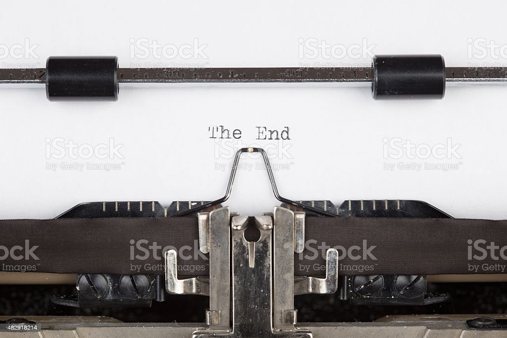 The End message printed on typing machine stock photo