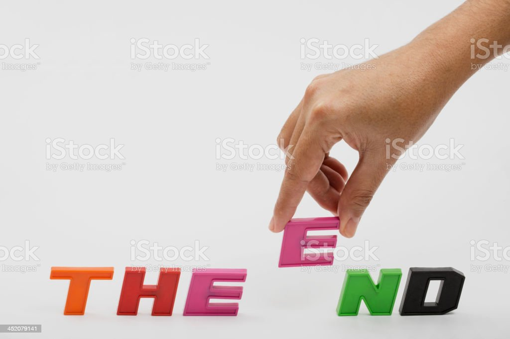The end,hand and word royalty-free stock photo