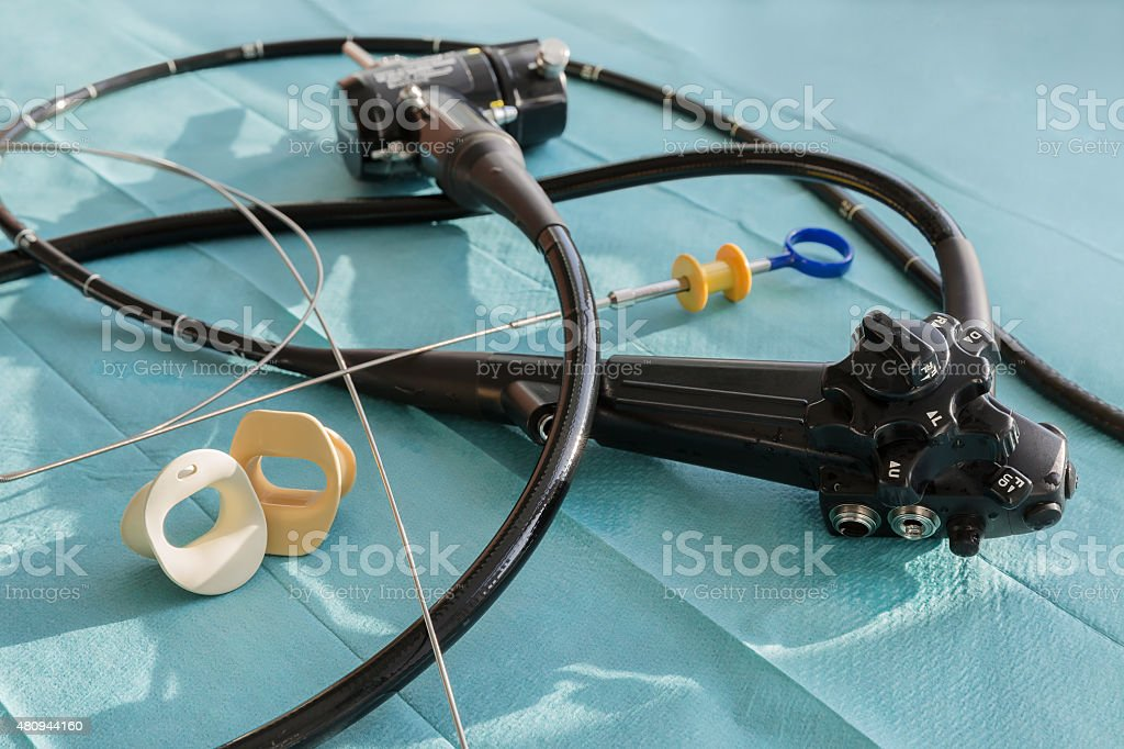 The endoscope, the mouthpiece and the biopsy forceps stock photo