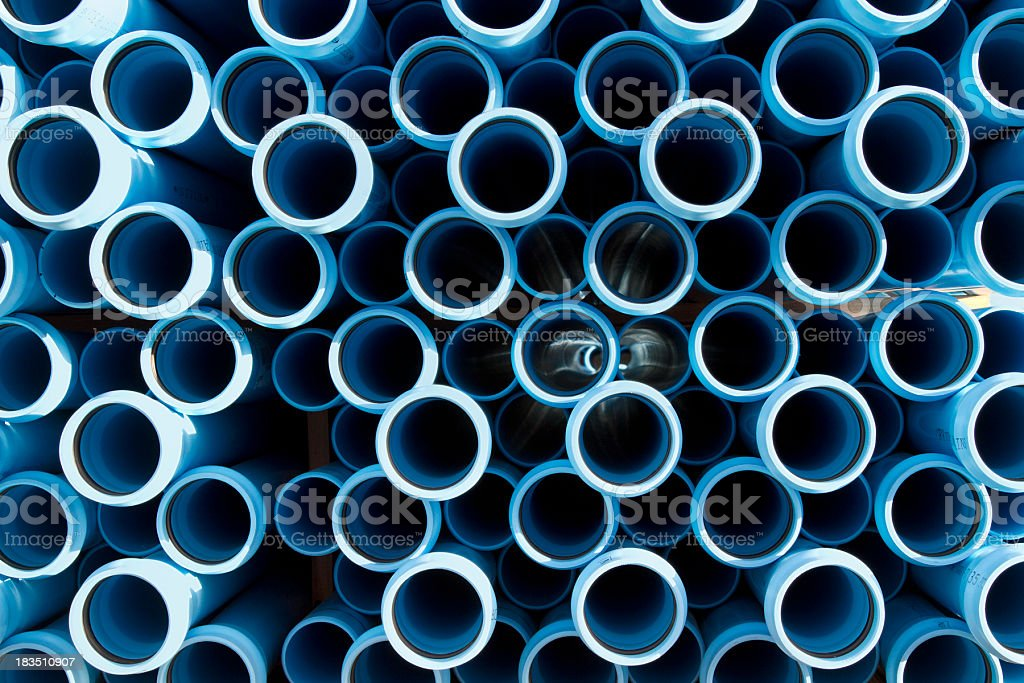 The ends of water pipes that are stacked together in a pile stock photo