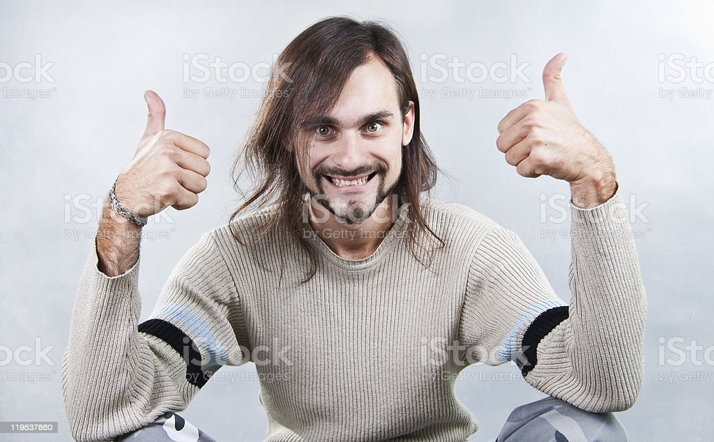 The energy young man holds fingers upwards stock photo