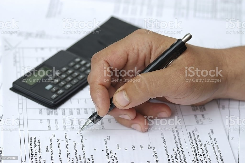 The engineer checks calculations. royalty-free stock photo