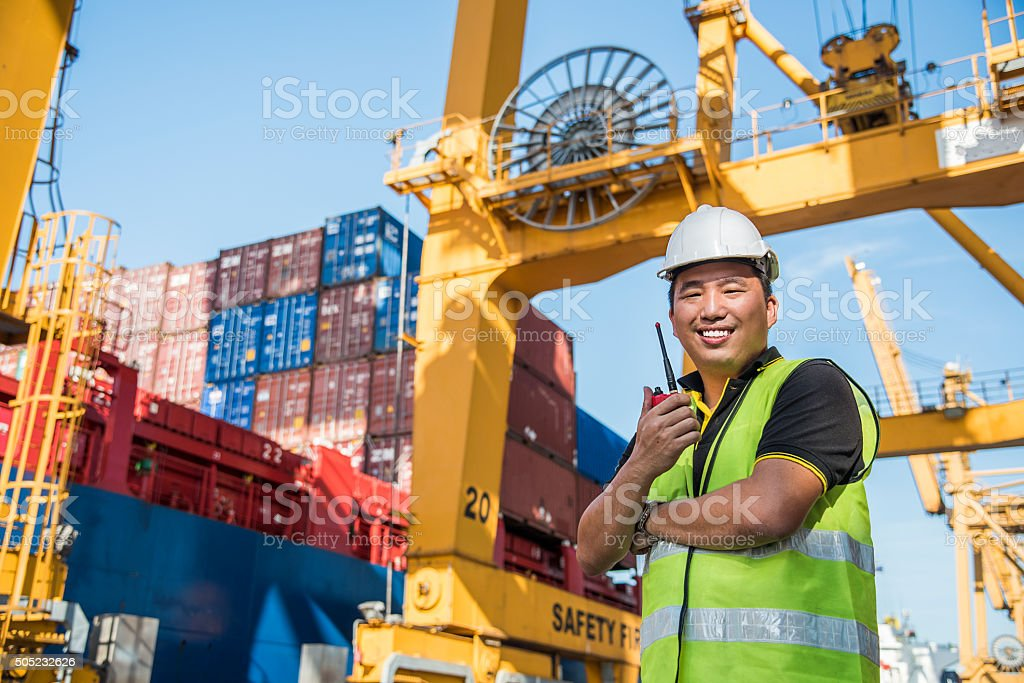 The engineer working with container Cargo freight ship in port stock photo