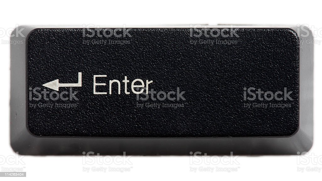 The enter key from a black keyboard stock photo