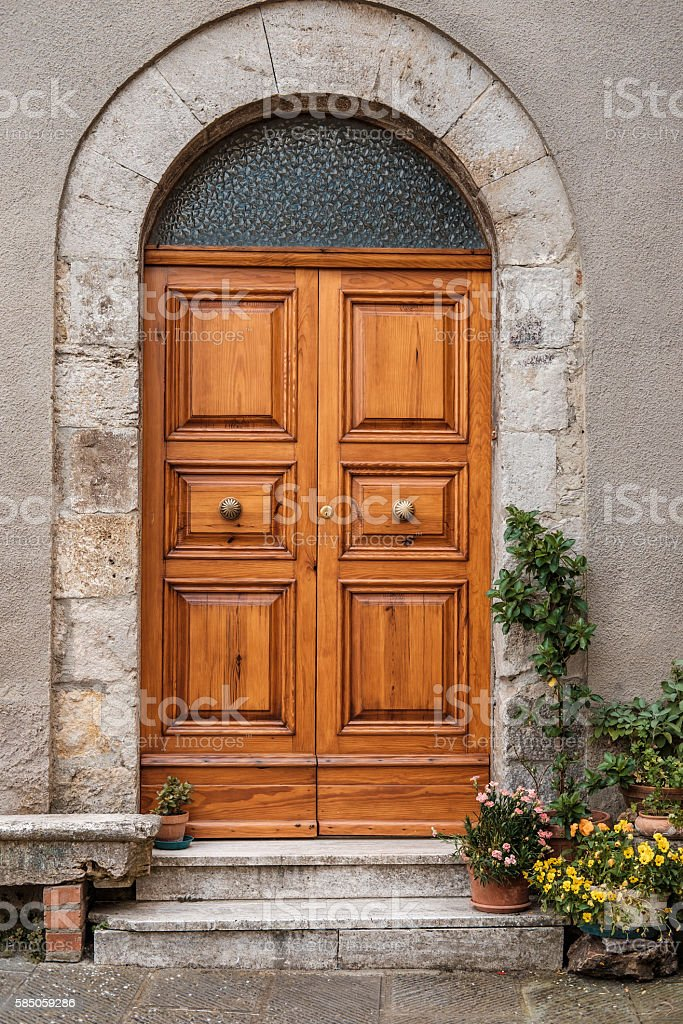 The entrance door in an old Italian house. stock photo
