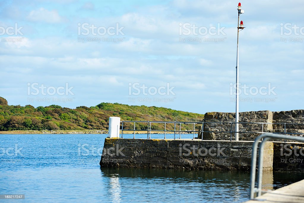 The entrance to a small Scottish harbour at high tide stock photo