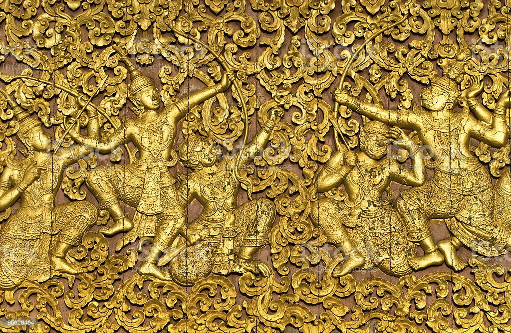 The epic ramayana carved on a wooden door royalty-free stock photo
