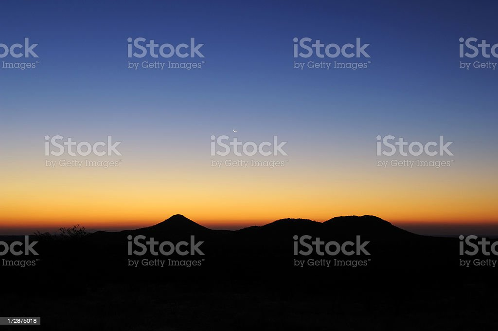 The Erongo mountains after sunset under crescent moon royalty-free stock photo