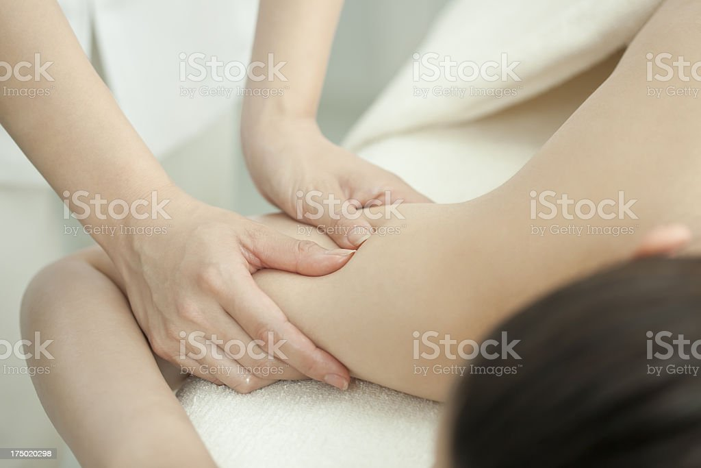 The esthetician who massages an arm royalty-free stock photo
