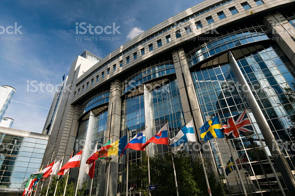 The European Parliament in Brussels with flags outside stock photo