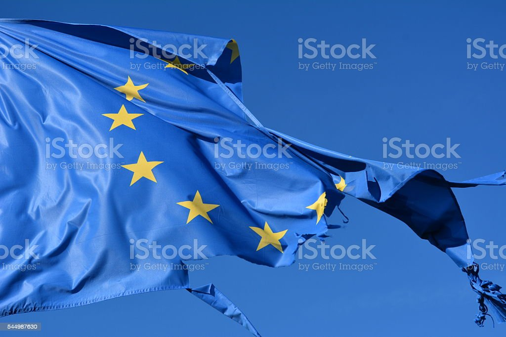 The european union twelve star flag torn and with knots stock photo
