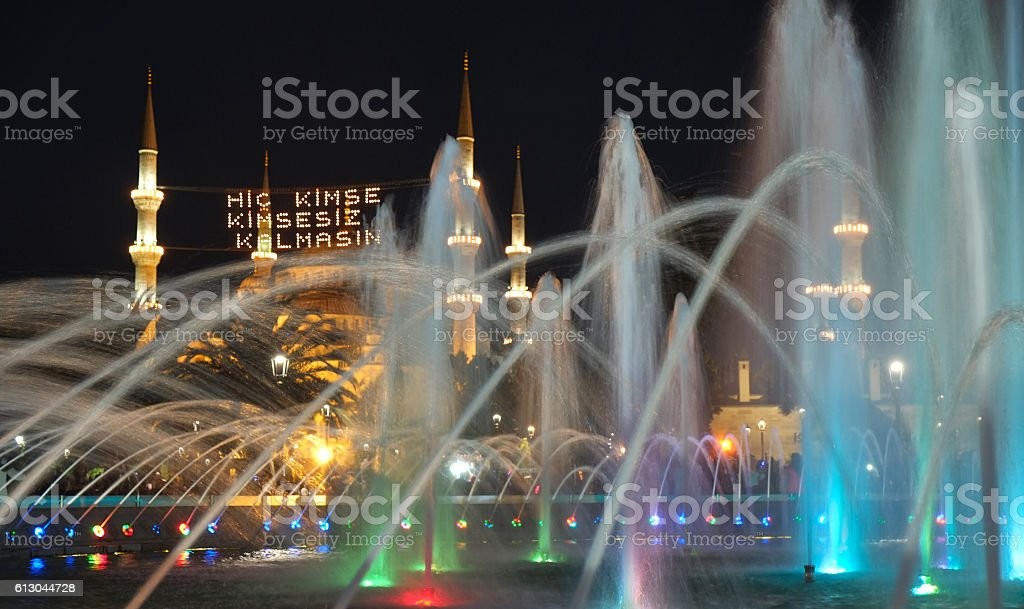 The evening illumination of fountain and Blue mosque stock photo