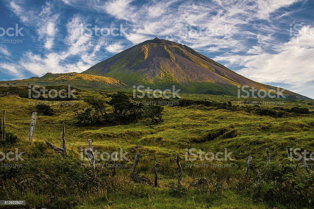 The evening sun gracing volcano Pico stock photo