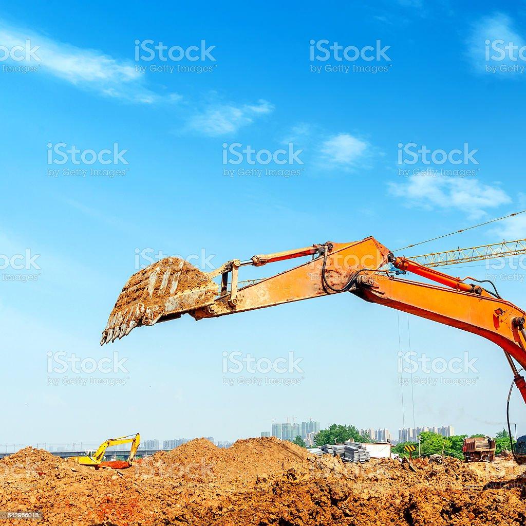 The excavator is dredging stock photo