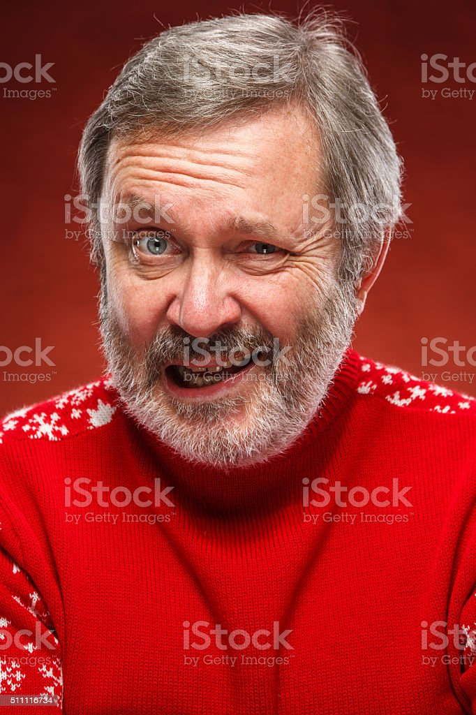 The expressive portrait on red background of a pouter man stock photo