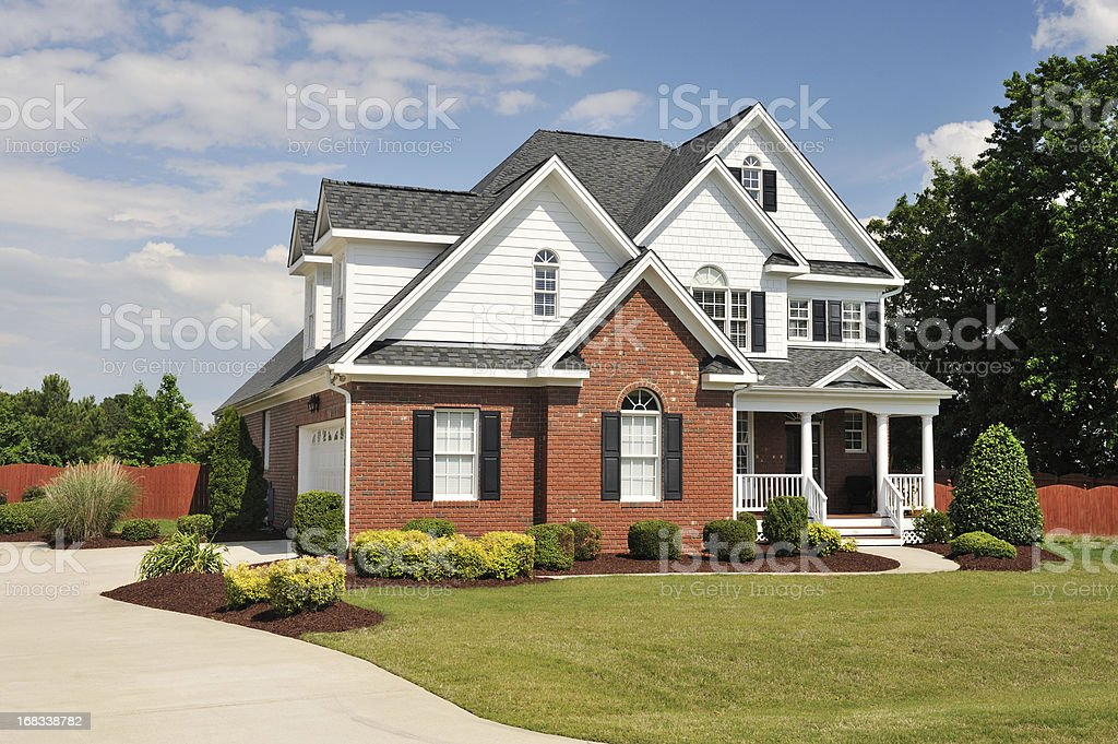 The exterior of a home with a landscaped lawn stock photo