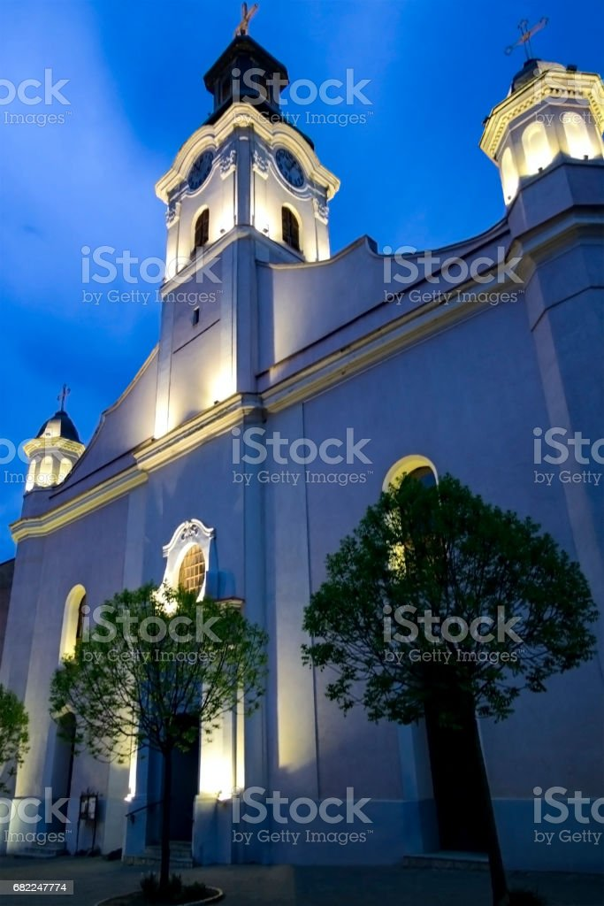 The facade of the Catholic church against the blue sky. stock photo