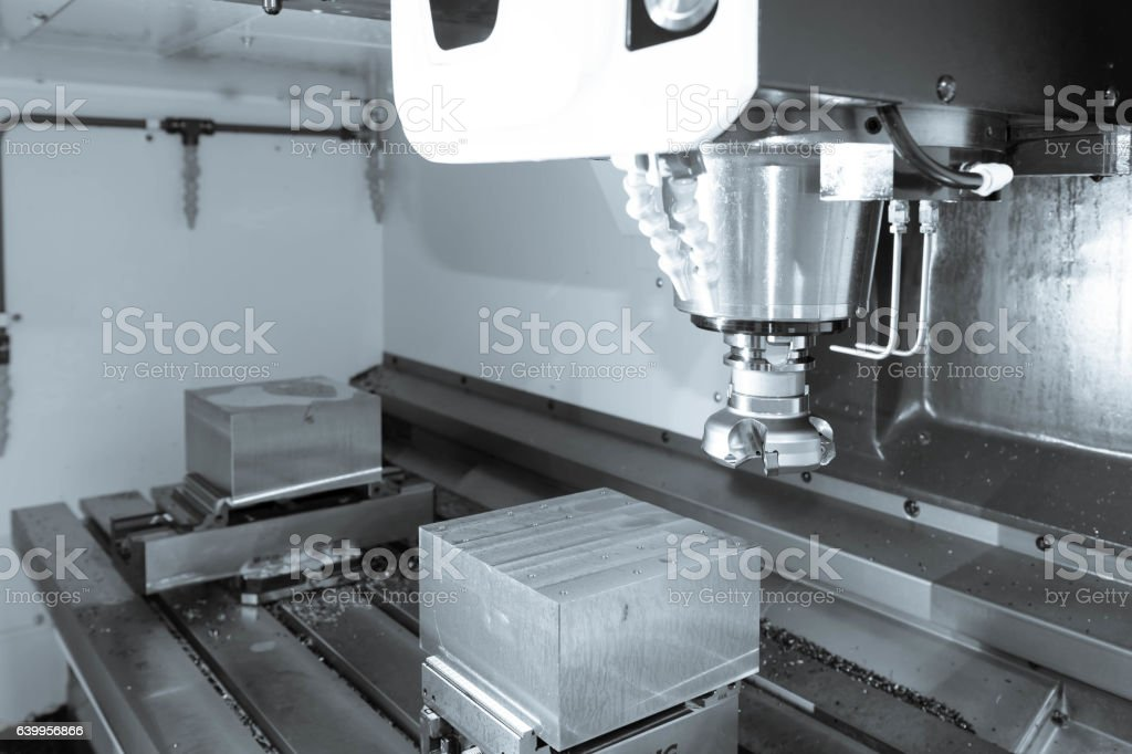 The face milling tool with the raw material work piece stock photo