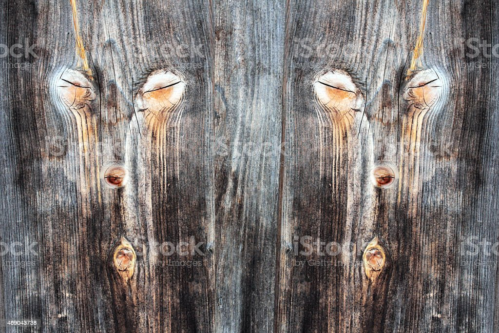 The face on the timber wall stock photo