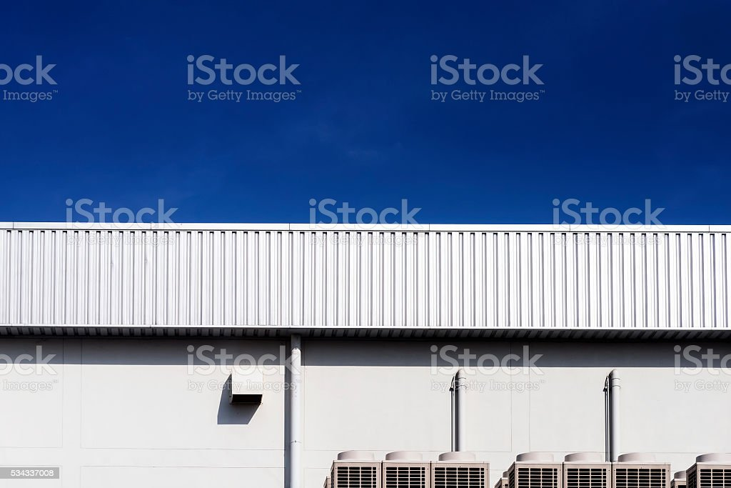 the factory wall and the blue sky day stock photo