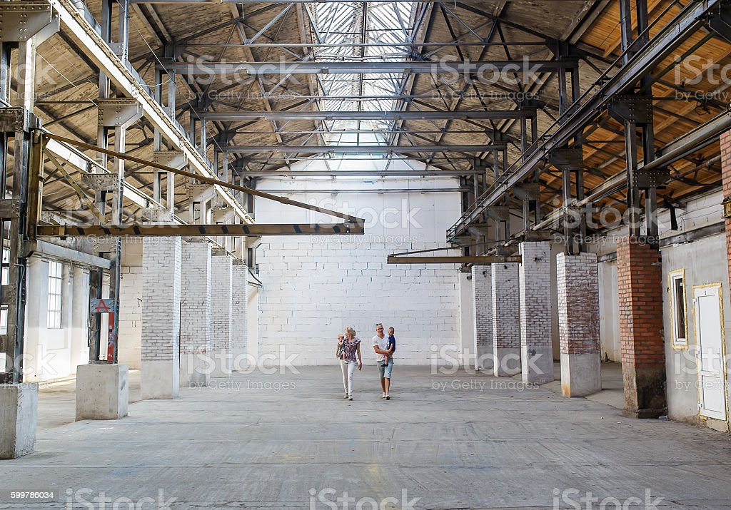 the family walks on the abandoned shop stock photo