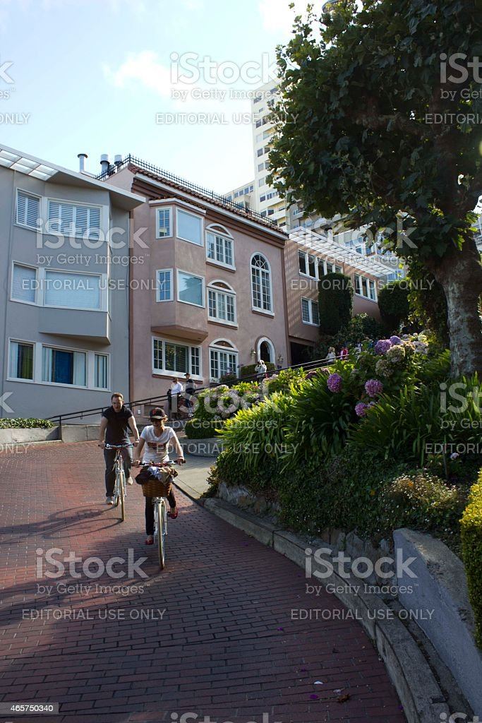 The famous Lombard Street, with two person on a bycicle. stock photo
