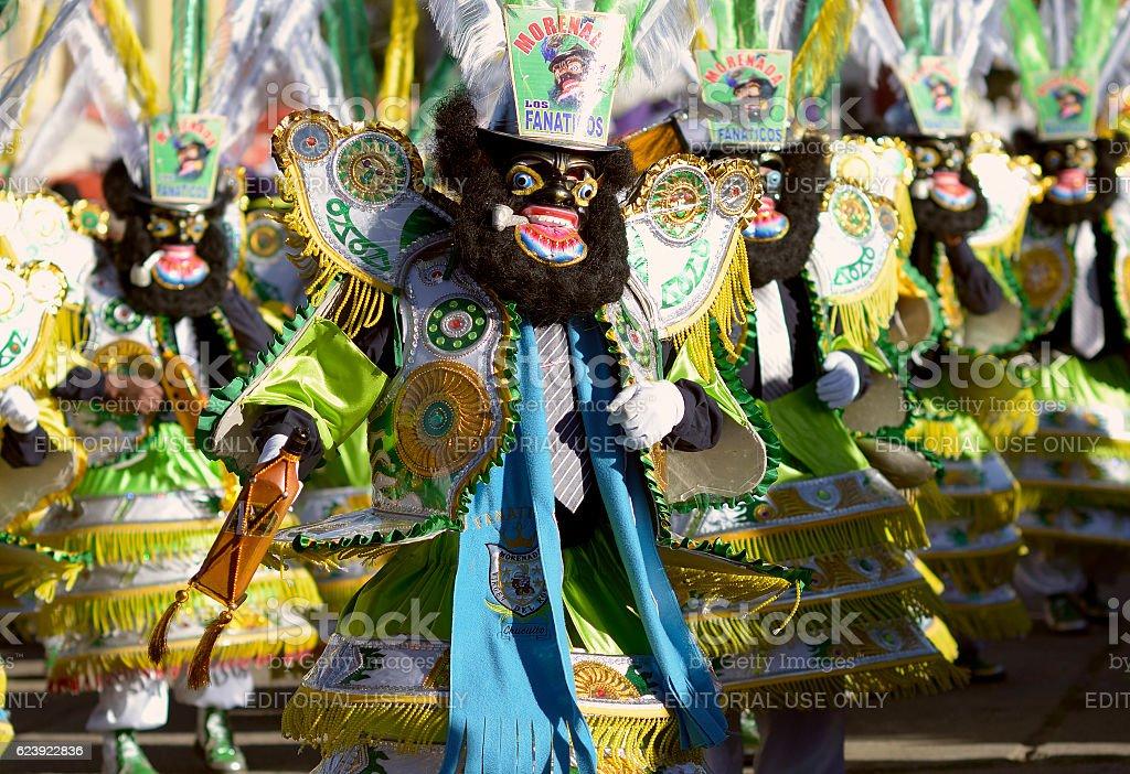 The famous 'negritos' dancers at a Festival, Chucuito, Puno, Peru. stock photo
