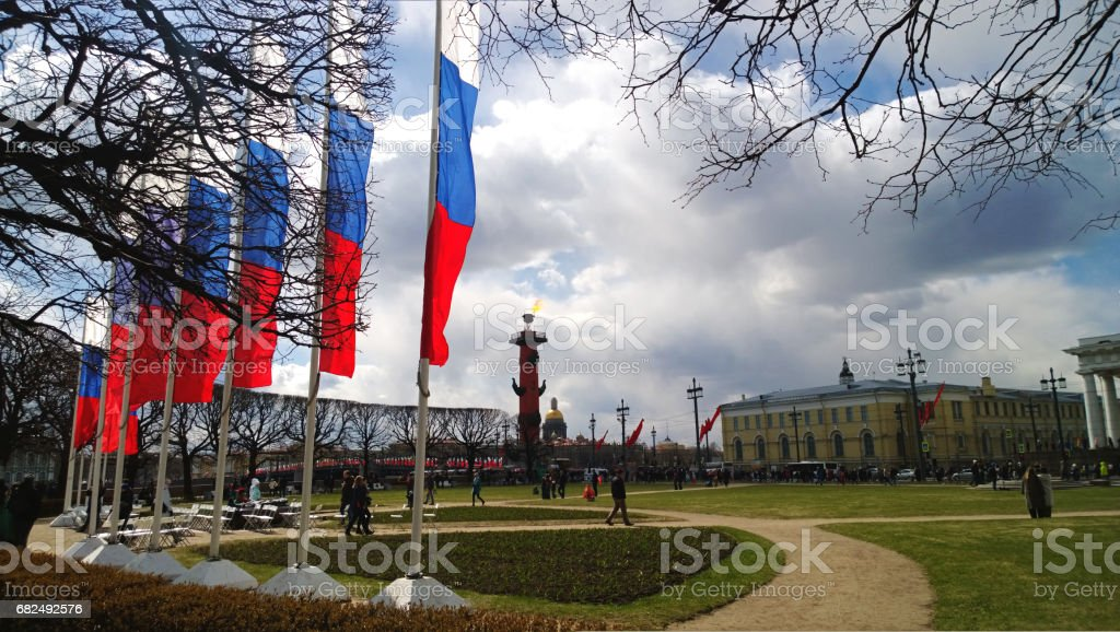 The famous spit of Vasilievsky island with the stock Exchange building, Rostral column and flags the Russian tricolor stock photo