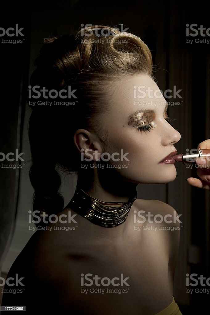 the fashion girl getting makeup royalty-free stock photo