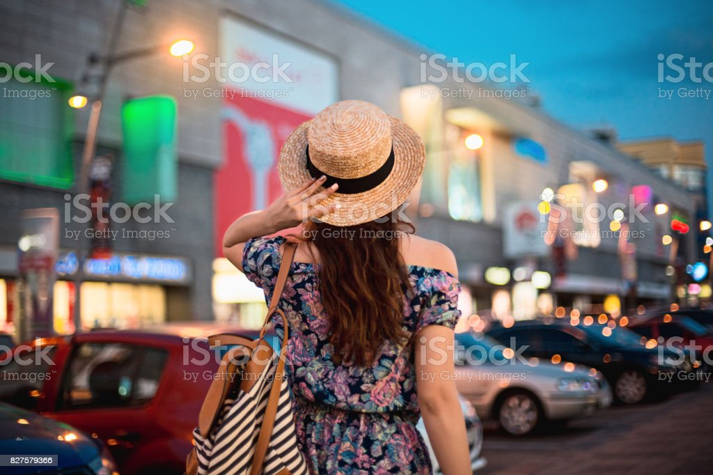The fashion woman portrait of young pretty trendy girl posing at the city in Europe stock photo