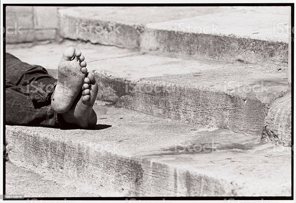 The Feet of a Homeless Man royalty-free stock photo