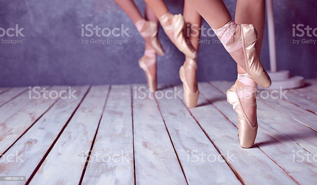 The feet of a young ballerinas in pointe shoes stock photo